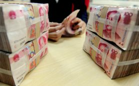 ЦБ Китая немного укрепил юань к доллару