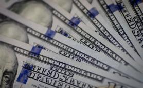 Средневзвешенный курс доллара на 11:30 мск вырос до 63,45 рубля